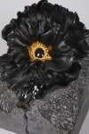 Black Poppy sculpted from Belgium black marble with 23K gold stamen.